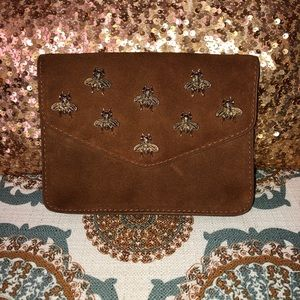 Cute clutch/crossbody with gold metal 🐝's.